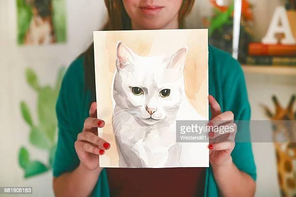 Artist showing aquarelle of a cat