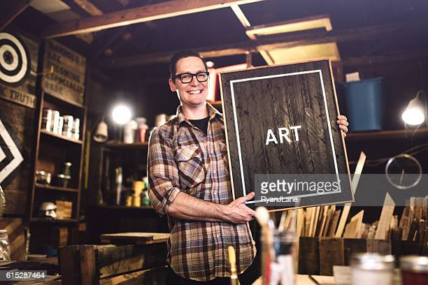 Artist Showing Wood Artwork