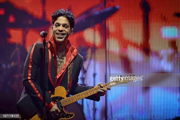 US artist singer and songwriter Prince performs on stage during his concert in Antwerp Sportpaleis on November 8 2010 AFP PHOTO /BELGA PHOTO DIRK WAEM