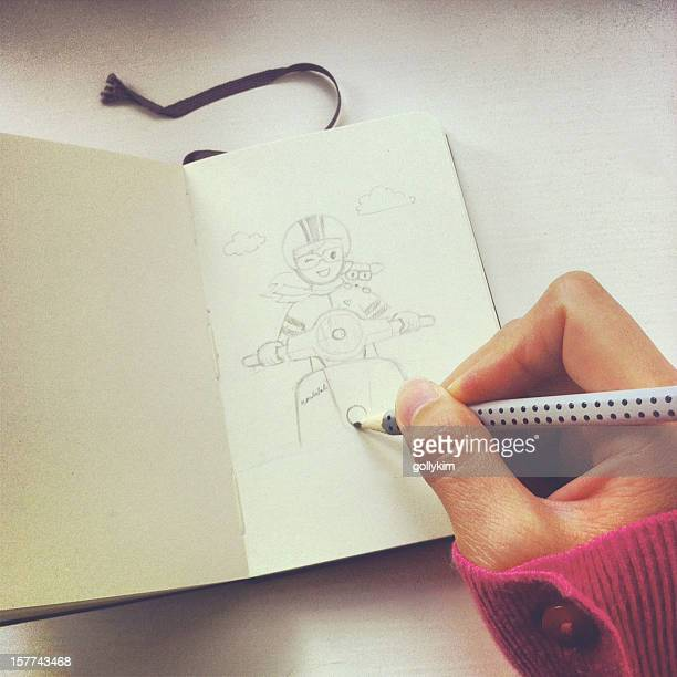 Artist sketching girl and scooter with pencil on sketch book