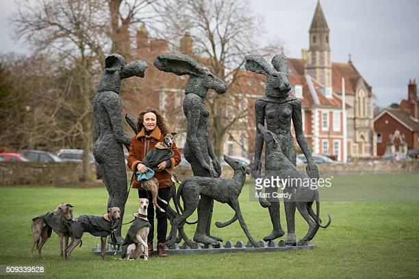 Artist Sophie Ryder and her dogs pose for a photograph with her sculpture Paint Pots that has been installed in the grounds of Salisbury Cathedral as...