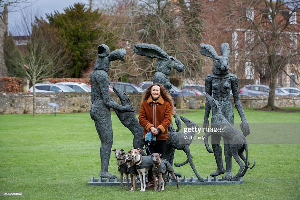 Artist Sophie Ryder and her dogs pose for a photograph with her sculpture, Paint Pots that has been installed in the grounds of Salisbury Cathedral as part of an exhibition by the artist on February 10, 2016 in Salisbury, England. The solo exhibition, Relationships, featuring life-sized Minotaurs, Lady Hares and giant 20ft high clasped hands installed in and around the historic Cathedral, opens on February 12 and runs until July 3.