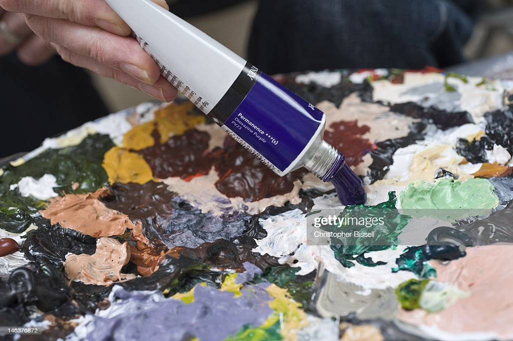 Artist squeezing acrylic Paint : Stock Photo