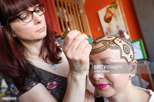 Artist Tarquin Singh of Henna Heals applies ornate henna to Madeline Urbina 19 in her studio in Toronto Madeline has alopecia an autoimmune disease...