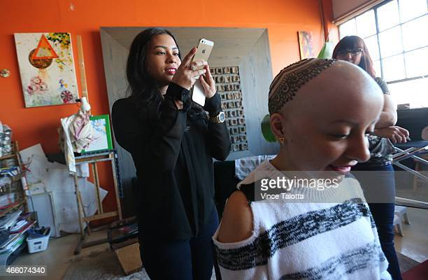 Artist Tarquin Singh of Henna Heals applies ornate henna to Madeline Urbina 19 as her sister Joselyn looked on in her studio in Toronto Madeline has...