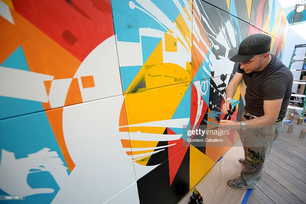 Artist Tes One creates a work of art during AD Oasis at The Raleigh on December 8, 2012 in Miami, Florida.