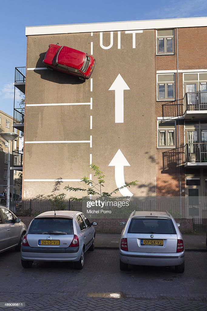 Artist Theo van Laar has designed a creative solution to solve his parking problem and installed his Mini high on a wall on May 09, 2014 in The Hague, Netherlands. (Photo Michel Porro/Getty Images).