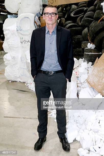 Artist Thomas Hirschhorn front of is work 'Eternal Flame' attends the Friend's of Palais De Tokyo's Dinner Held at Palais De Tokyo on May 20 2014 in...