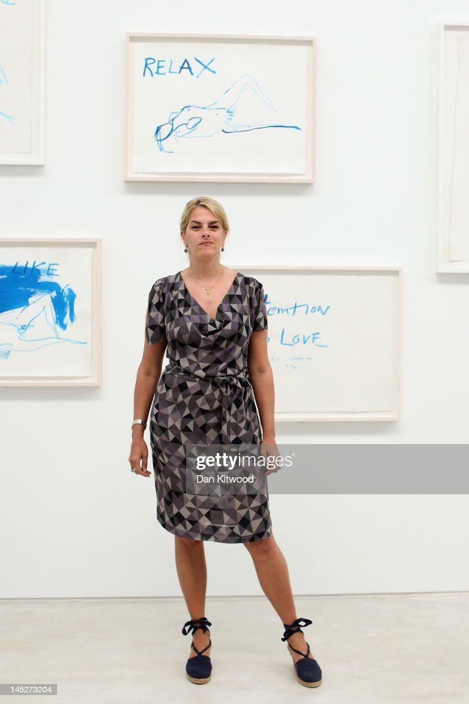Artist <a gi-track='captionPersonalityLinkClicked' href=/galleries/search?phrase=Tracey+Emin&family=editorial&specificpeople=203219 ng-click='$event.stopPropagation()'>Tracey Emin</a> poses for a picture in front of her artwork at the Turner Contemporary Gallery on May 25, 2012 in Margate, England. The new exhibition, 'She Lay Down Deep Beneath The Sea', includes a series of new pieces by the artist. The show is her first solo exhibition at the Turner Contemporary Gallery in Margate, her home town.