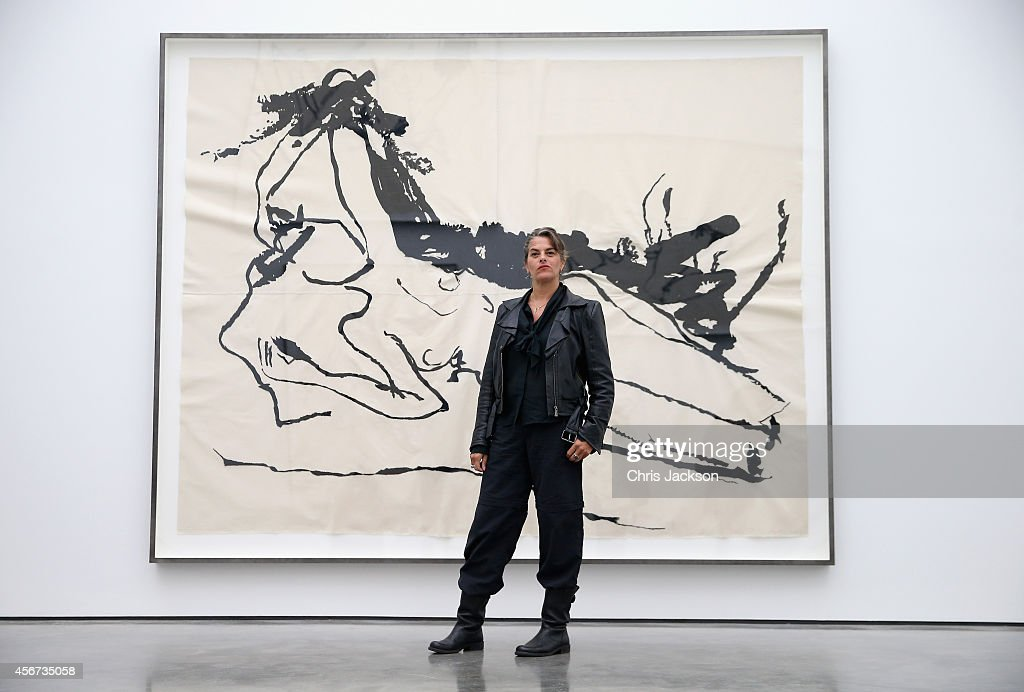 Artist Tracey Emin poses in front of her work as part of her 'The Last Great Adventure is You' Exhibition at the White Cube Gallery on October 6 2014...