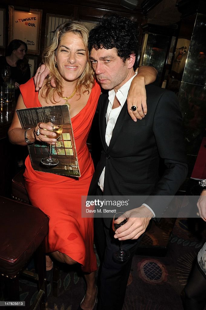 Artist <a gi-track='captionPersonalityLinkClicked' href=/galleries/search?phrase=Tracey+Emin&family=editorial&specificpeople=203219 ng-click='$event.stopPropagation()'>Tracey Emin</a> poses with Tim Noble as she celebrates her 49th Birthday at Annabels Night Club on July 3, 2012 in London, England.