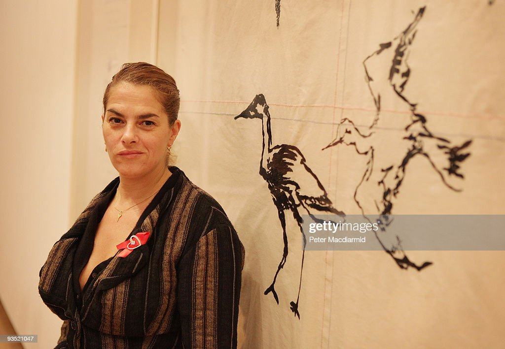 Artist Tracey Emin stands in front of her new painting entitled 'Throw Yourself at Anyone 2009' at the Royal Academy of Arts 'Earth Art of a Changing...