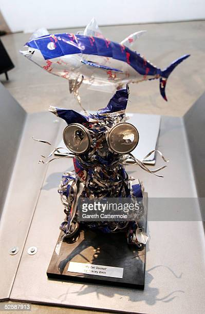 Artist Tracey Emin's creation of her cat is pictured in front of DJ Chris Tarrents creation of a fish at the Red Bull Art Of Can private view and...