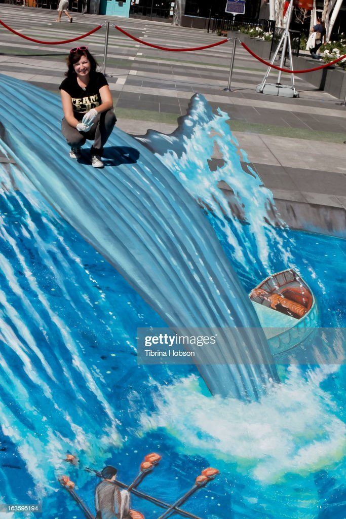 Artist Tracy Lee Stum recreates an iconic scene from the movie 'Life Of Pi' in 3D chalk art at L.A. LIVE on March 12, 2013 in Los Angeles, California.