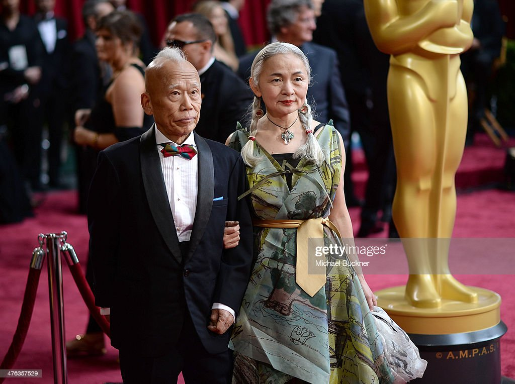 Artist Ushio Shinohara (L) and Noriko Shinohara attend the Oscars held at Hollywood & Highland Center on March 2, 2014 in Hollywood, California.
