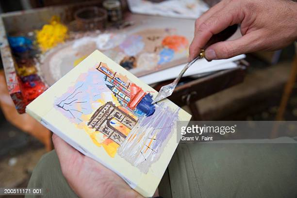 Artist using painting knife, close-up
