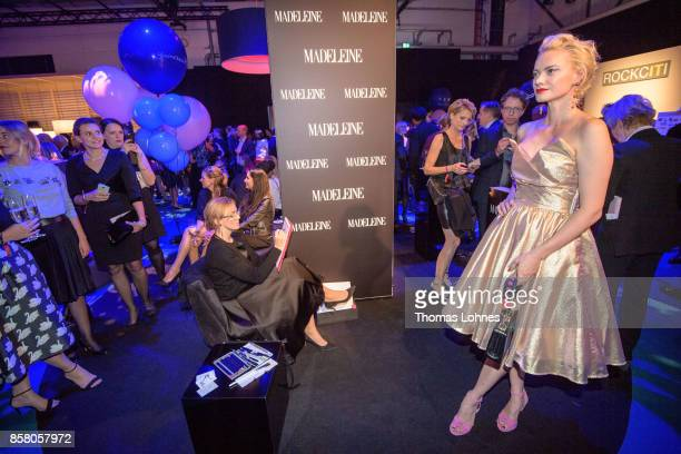 Artist Virgina Romo pencils Franziska Knuppe during the Tribute To Bambi at Station on October 5 2017 in Berlin Germany