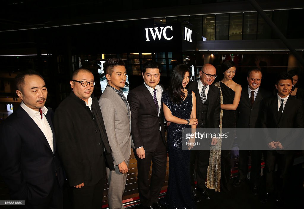 Artist Wang Lu Yan, flim director Wang Xiao Shuai, Actor Alec Su, Managing Director of IWC China Dennis Lee, actress Zhu Zhu, CEO of IWC Georges Kern, actress Tang Wei, Managing Director of IWC Asia Pacific Benoit de Clerck and Olympic gold medalist Chen Yibing pose for photographs during the IWC Flagship Boutique Opening on November 22, 2012 in Beijing, China.