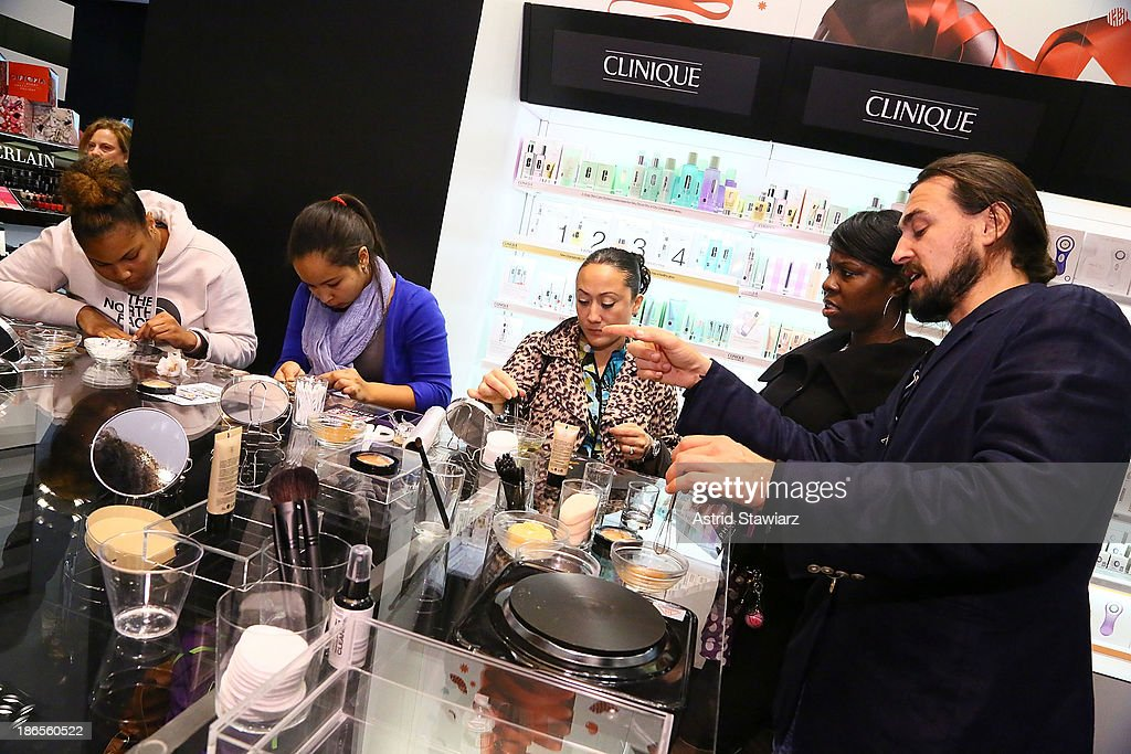 Artist Will Lemon (right) demonstrates how to create makeup using Sephora products and natural ingredients during Sephora Brooklyn Grand Opening on November 1, 2013 in New York City.
