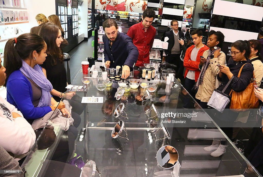 Artist Will Lemon (center) demonstrates how to create makeup using Sephora products and natural ingredients during Sephora Brooklyn Grand Opening on November 1, 2013 in New York City.