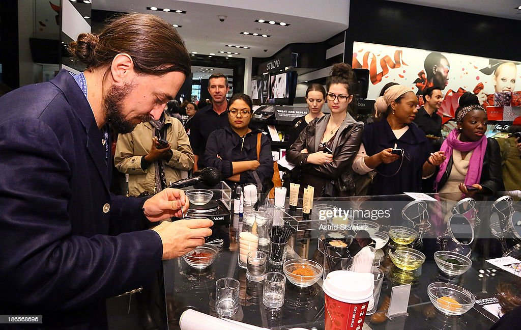 Artist Will Lemon (left) demonstrates how to create makeup using Sephora products and natural ingredients during Sephora Brooklyn Grand Opening on November 1, 2013 in New York City.