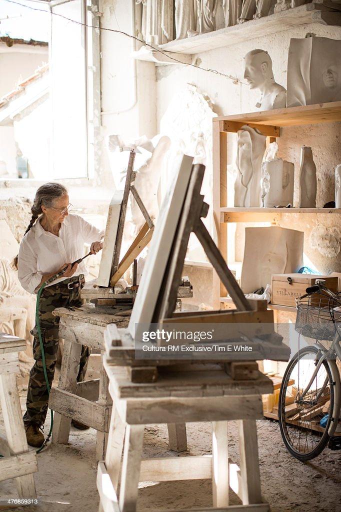 Artist working in studio, Pietrasanta, Tuscany, Italy