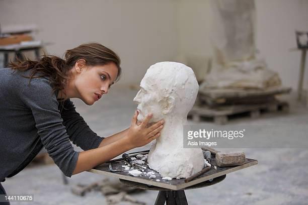 artist working on bust