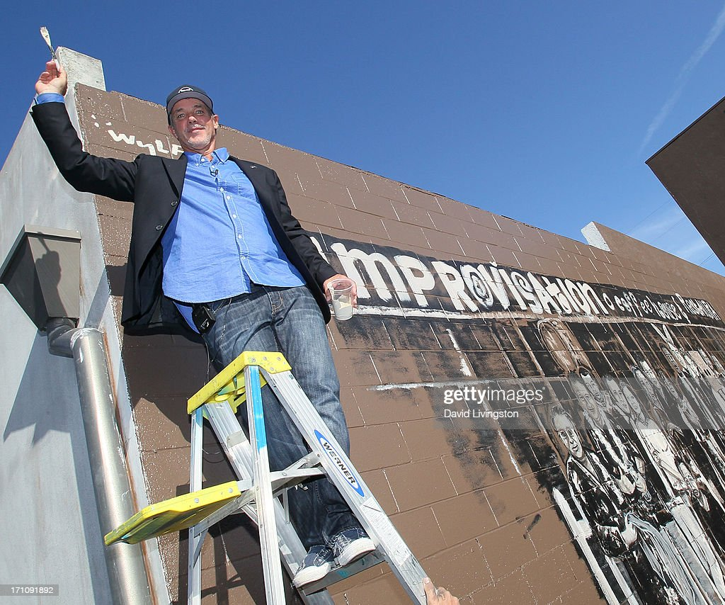 the hollywood improv and the wyland foundation mural unveiling and artist wyland attends the hollywood improv and the wyland foundation mural unveiling and comics for