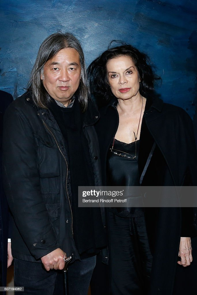 Artist Yan Pei-Ming (in front of his work), Actress Bianca Jagger attend the 'Bentu' Exhibition at the Louis Vuitton Foundation, Co-organized with the 'Ullens Center for Contemporary Art of Pekin' - As part of Spring Summer 2016 Paris Fashion Week on January 26, 2016 in Paris, France.