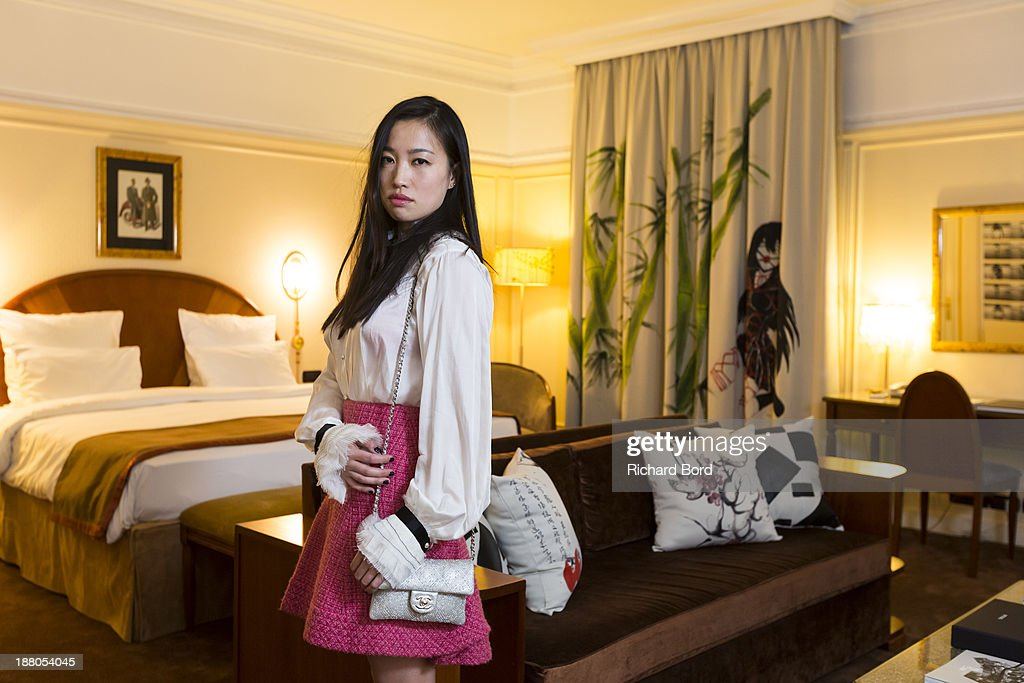 Artist Yi Zhou dressed by Chanel poses in her 'Paradise Suite' she has designed at Hotel Lutetia on November 14, 2013 in Paris, France.