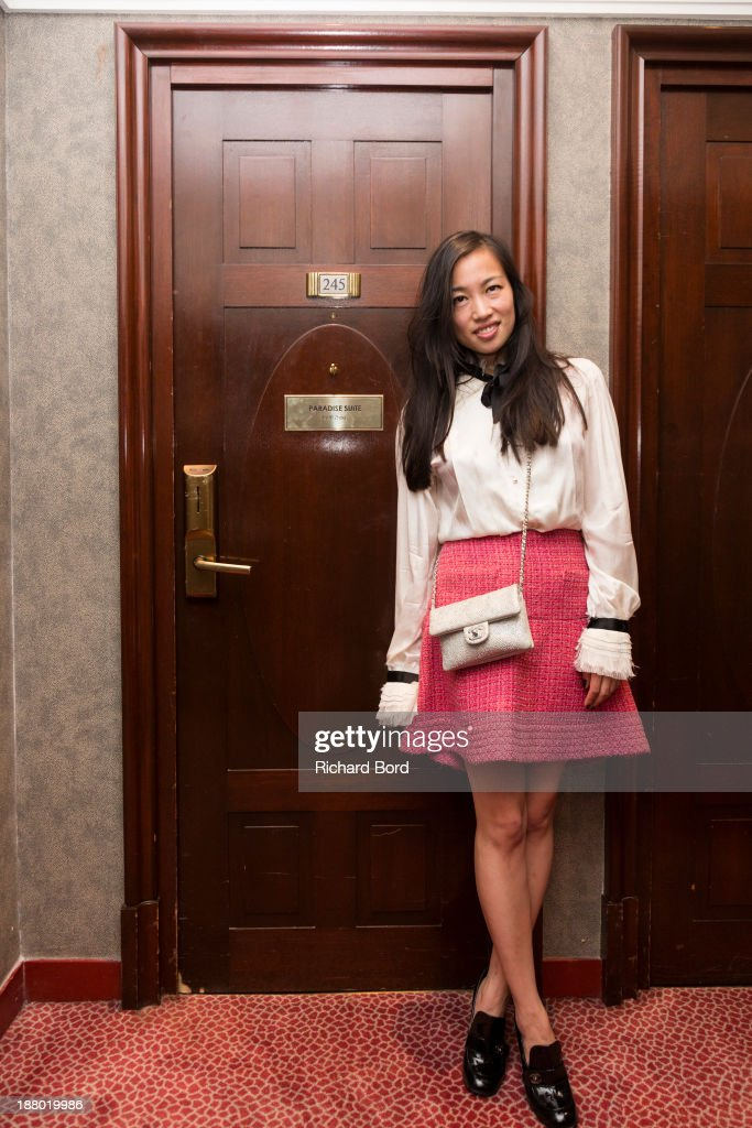 Artist Yi Zhou dressed by Chanel poses in the front of her 'Paradise Suite' door at Hotel Lutetia on November 14, 2013 in Paris, France.