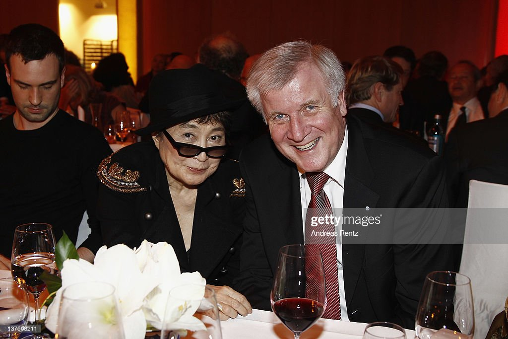 Artist Yoko Ono and Horst Seehofer, Chairman of the Christian Social Union (CSU) attend the Chairmen & Speaker Dinner during the DLD Conference 2012 at the Jewish Community Centre on January 22, 2012 in Munich, Germany.