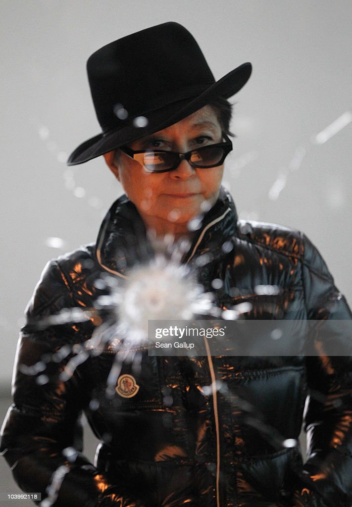 Artist Yoko Ono stands in front of her piece 'A Hole' ahead of the opening of her art installation 'Das Gift' at the Haunch of Venison gallery on September 10, 2010 in Berlin, Germany.