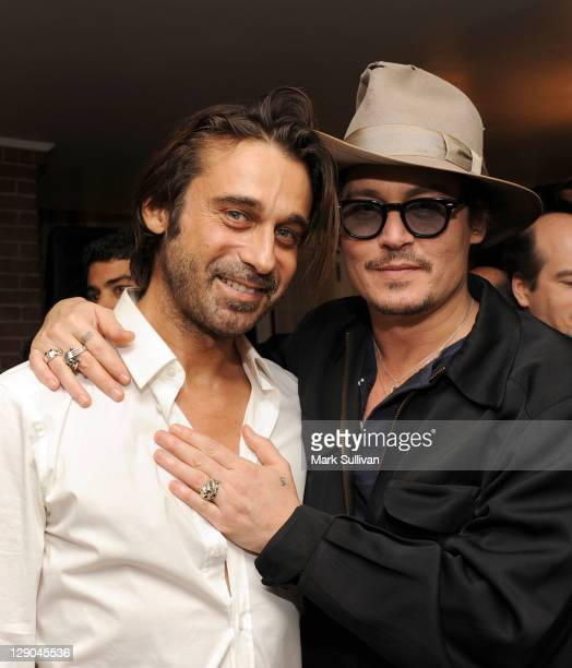 Artist/actor Jordi Molla and actor Johnny Depp attend Haute Living art exhibit with Jordi Molla and Domingo Zapata at Chateau Marmont on October 11...