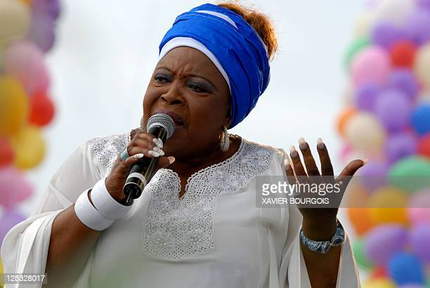 Artiste and singer Patience Dabany mother of Gabonese President Ali Bongo performs during a ceremony presenting the official 'Gaguie' mascot for the...