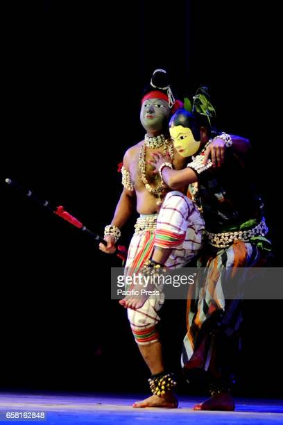 Artistes from performs Chhau dance at 'Chhau Parva' organised by Sangeet Natak Akademi New Delhi in association with Kollol and Rangalaya Nagaon at...