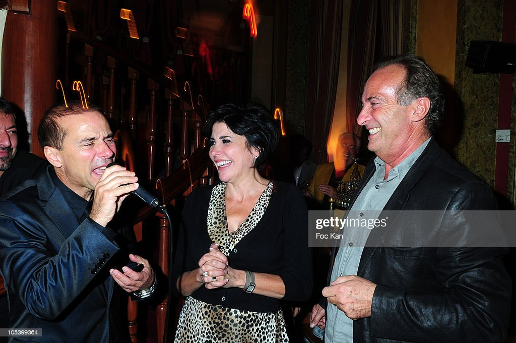 Artistic agent Patrick Goavec, comedian/imitator Yves Lecoq and singer <a gi-track='captionPersonalityLinkClicked' href=/galleries/search?phrase=Liane+Foly&family=editorial&specificpeople=961880 ng-click='$event.stopPropagation()'>Liane Foly</a> attend the Patrick Goavec Birthday Party at the Berkeley Club on September 14, 2009 in Paris, France.
