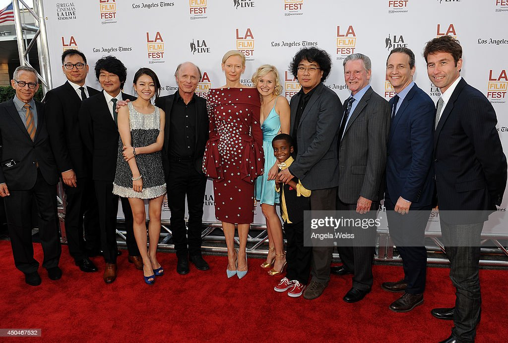 LAFF artistic director David Ansen, producer Dooho Choi, actors Kang-ho Song, Ah-sung Ko, <a gi-track='captionPersonalityLinkClicked' href=/galleries/search?phrase=Ed+Harris&family=editorial&specificpeople=215262 ng-click='$event.stopPropagation()'>Ed Harris</a>, <a gi-track='captionPersonalityLinkClicked' href=/galleries/search?phrase=Tilda+Swinton&family=editorial&specificpeople=202991 ng-click='$event.stopPropagation()'>Tilda Swinton</a>, <a gi-track='captionPersonalityLinkClicked' href=/galleries/search?phrase=Alison+Pill&family=editorial&specificpeople=585936 ng-click='$event.stopPropagation()'>Alison Pill</a>, Marcanthonee Reis, director Joon-ho Bong, writer Kelly Masterson, RADiUS-TWC co-presidents Tom Quinn and Jason Janego attend the opening night premiere of 'Snowpiercer' during the 2014 Los Angeles Film Festival at Regal Cinemas L.A. Live on June 11, 2014 in Los Angeles, California.