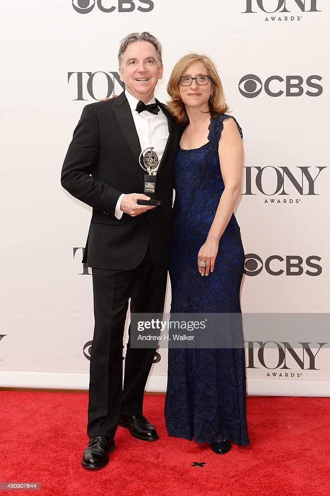 Artistic Director James Houghton (L) and Executive Director Erika Mallin of Signature Theater, winners of the Regional Theatre Award pose in the press room during the 68th Annual Tony Awards on June 8, 2014 in New York City.