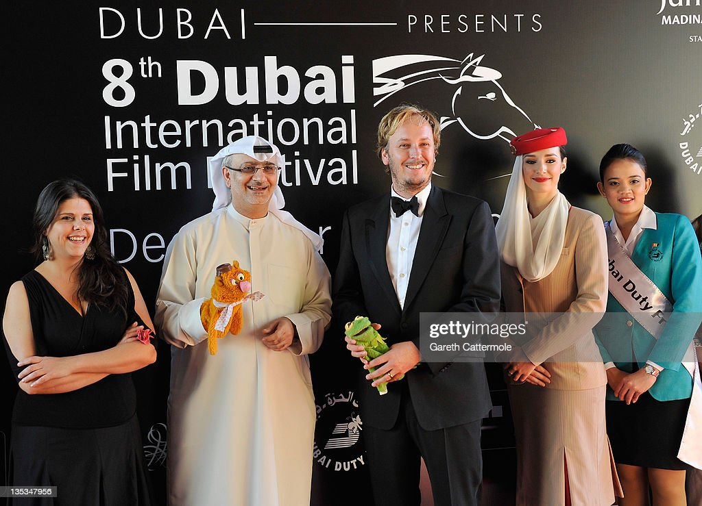 Artistic Director of DIFF Masoud Amralla Al Ali (second left) and director James Bobin (C) attend 'The Muppets' premiere during day three of the 8th Annual Dubai International Film Festival held at the Madinat Jumeriah Complex on December 9, 2011 in Dubai, United Arab Emirates.