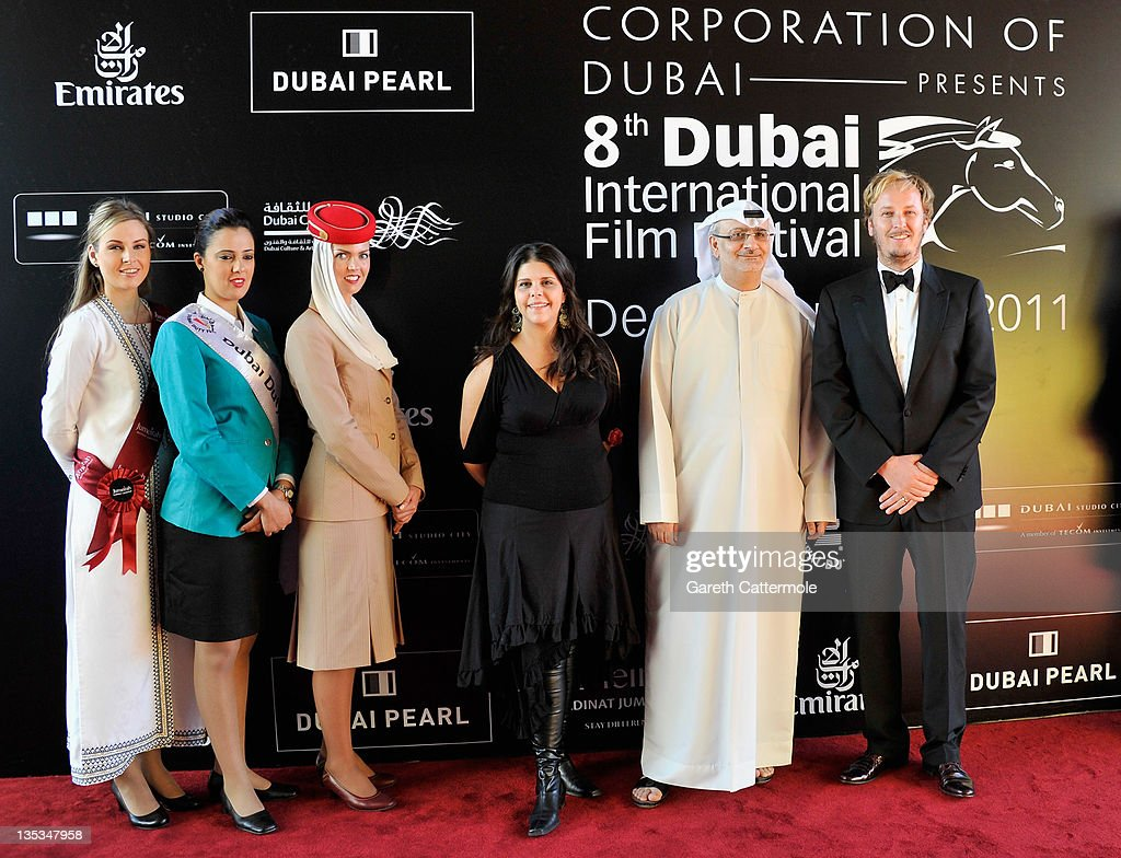 Artistic Director of DIFF Masoud Amralla Al Ali (second right) and director James Bobin (R) and guests attend 'The Muppets' premiere during day three of the 8th Annual Dubai International Film Festival held at the Madinat Jumeriah Complex on December 9, 2011 in Dubai, United Arab Emirates.