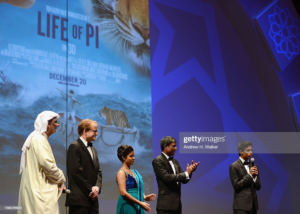 Artistic Director of DIFF Masoud Amralla Al Ali, guest and actors Shravanthi Sainath, Adil Hussain and Suraj Sharma on stage ahead of the 'Life of PI' Opening Gala during day one of the 9th Annual Dubai International Film Festival held at the Madinat Jumeriah Complex on December 9, 2012 in Dubai, United Arab Emirates.