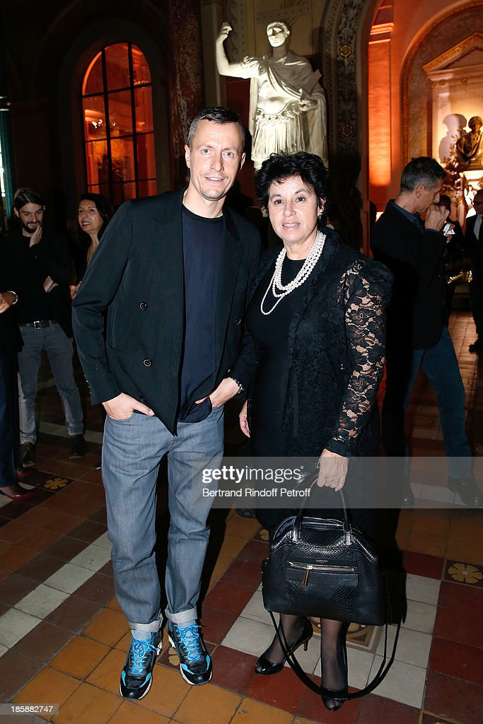 Artistic Director of Lanvin Homme, Lucas Ossendrijver and General Manager of Lanvin Michele Huiban - Designer Alber Elbaz pays tribute to Cesar Baldaccini by an Evening Pic-Nic at the Ecole Nationale Superieure des Beaux Arts de Paris on October 25, 2013 in Paris, France.