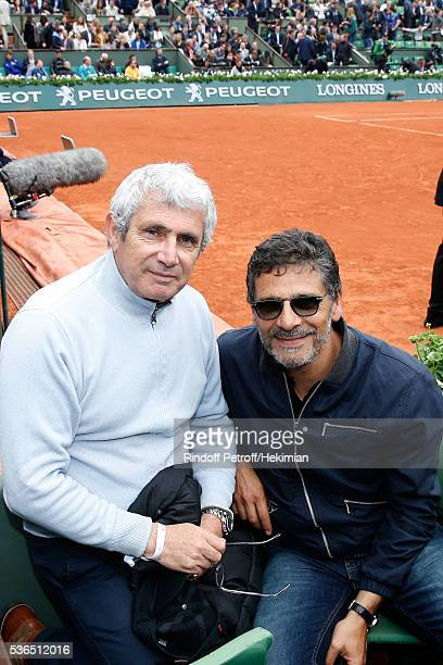 Artistic Director of Ramatuelle Festival Michel Boujenah and actor Pascal Elbe attend Day Eleven of the 2016 French Tennis Open at Roland Garros on...