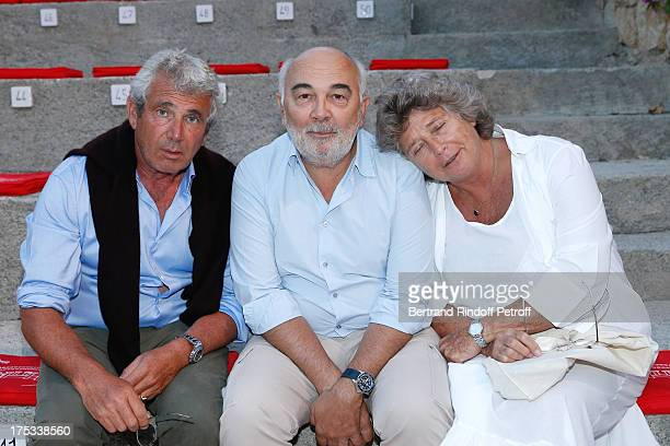 Artistic Director of the Festival Michel Boujenah actor Gerard Jugnot and President of Ramatuelle Festival Jacqueline Franjou attend 'Student and Mr...