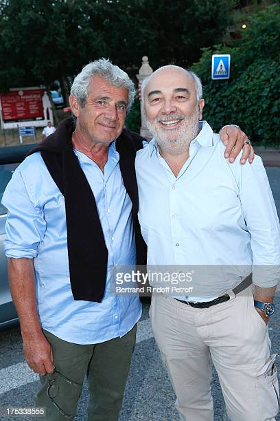 Artistic Director of the Festival Michel Boujenah and actor Gerard Jugnot attend 'Student and Mr Henri' play at 29th Ramatuelle Festival Day 3 on...