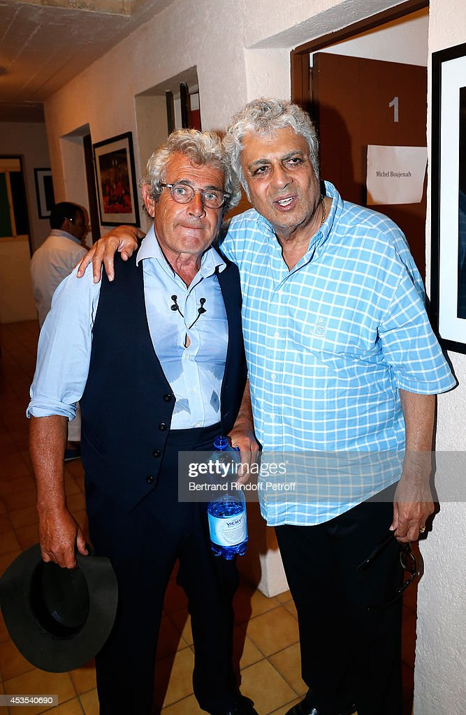 Artistic Director of the Festival <a gi-track='captionPersonalityLinkClicked' href=/galleries/search?phrase=Michel+Boujenah&family=editorial&specificpeople=1027167 ng-click='$event.stopPropagation()'>Michel Boujenah</a> and singer <a gi-track='captionPersonalityLinkClicked' href=/galleries/search?phrase=Enrico+Macias&family=editorial&specificpeople=2057443 ng-click='$event.stopPropagation()'>Enrico Macias</a> pose backstage after the <a gi-track='captionPersonalityLinkClicked' href=/galleries/search?phrase=Michel+Boujenah&family=editorial&specificpeople=1027167 ng-click='$event.stopPropagation()'>Michel Boujenah</a>'s show 'Ma vie revee' for the last evening of the 30th Ramatuelle Festival : Day 12 on August 12, 2014 in Ramatuelle, France.
