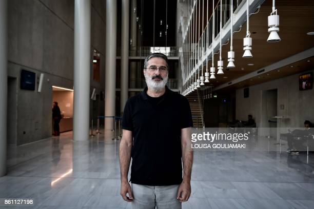 Artistic director of the 'national lyric scene' Georges Koumendakis poses on October 10 2017 in Athens on the sideline of a rehearsal of Richard...