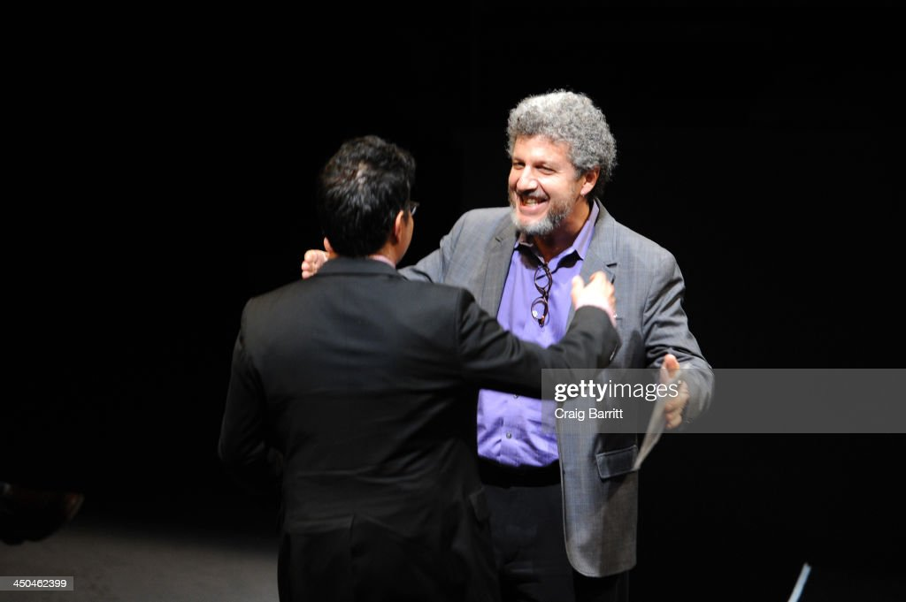 Artistic Director Todd London (R) welcomes playwright Rajiv Joseph onstage at The 2013 Steinberg Playwright 'Mimi' Awards presented by The Harold and Mimi Steinberg Charitable Trust at Lincoln Center Theater on November 18, 2013 in New York City.