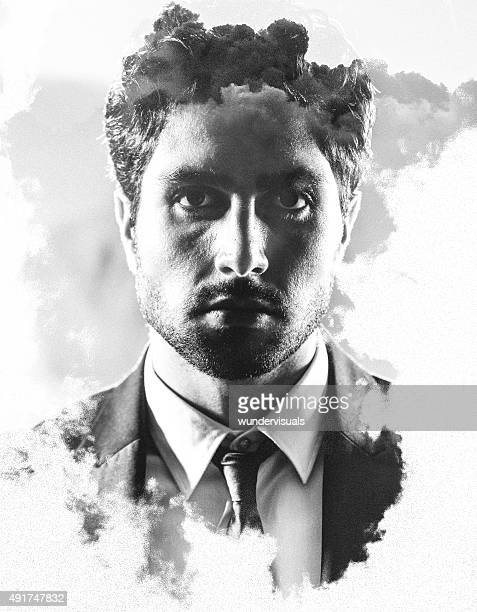 Artistic double exposure of a businessman with clouds